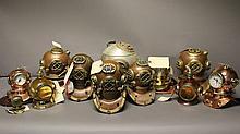 12 various replica diving helmets.