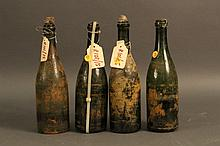 Four Champagne Bottles from