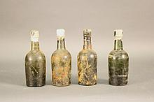 Four Beer Bottles from