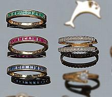 A GOLD, DIAMOND, RUBY, SAPPHIRE AND EMERALD BAND RING SET
