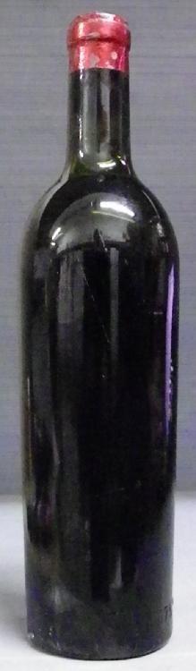 1 Bouteille AUSONE sans étiquette, niveau très légèrement bas, millésime sur le bouchon.  No label cork stamped, level very top shoulder.  1953