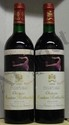 2 Bouteilles MOUTON ROTHSCHILD Etiquettes tachées.  Labels stained.  1990