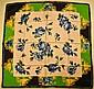 GOKAN KOBO TOUCH Foulard en soie vert, noir et blanc à décor de fleurs bleues - Dimensions : 86 x 87 cm - Size : 33,8 x 34,2 in. (petit fil tiré, petites tâches/small pull, small stains)