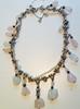 CHRISTIAN LACROIX Collier coeur en métal argenté, orné de pampilles de quartz rose et de perles de rivière    Longueur : 40 cm
