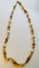 CHANEL par ROBERT GOOSSENS Collier en métal doré alterné de perles fantaisies baroques et de strass blancs    Circa 1960    Longueur : 62 cm