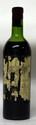 1 Bouteille Ausone 1961  Étiquette très abîmée, niveau mi épaule, millésime sur le bouchon. Label damaged, level mid shoulder, vintage stamped on the cork.