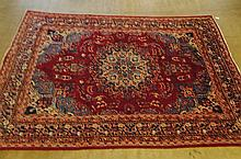 An Old Room-size Kirman Rug,