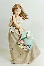VINTAGE PORCELAIN FIGURINE OF A GIRL W/ HAT AND FLOWERS