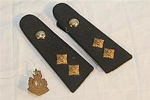 A pair of epaulettes and a badge