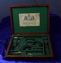 A Cased Pair Of English Percussion Pistols,
