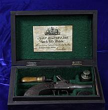 A Cased Gold Miners Percussion Pistol & Accessories,