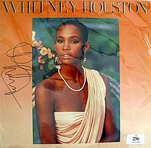 A Whitney Houston, LP self titled album signed to front cover