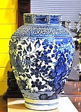 A pair of Chinese 19th Century blue and white decorated octagonal form jar, 56cm H (one vase AF)