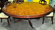 A magnificent mahogany and birds eye maple circular banquet table, with perimeter leaf extension, 205cm D