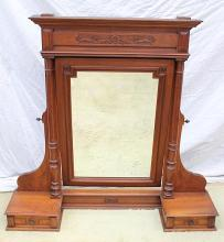 An antique French walnut chest of drawers mirror
