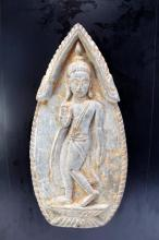 A Thai Votive Terracotta Plaque, with traditional hand gestures,
