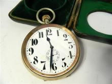 A travelling leather cased fob style clock