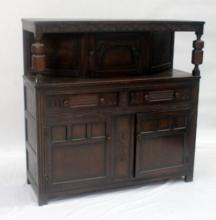 A 1920's oak court cupboard in the Tudor revival style