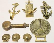 A collection of nautical brass items including door knockers, stylised hooks & a sun dial [8]