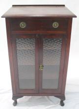 A two door one drawer side cabinet