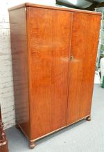 A large two door maple wardrobe