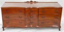 A serpentine front chest of nine drawers