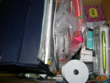 A box of assorted stationery items