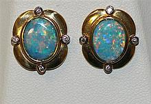 BA pair of opal and diamond stud earringsP Two oval solid opals, 3.00ct in total, blue red in colour with eight round brilliant ...