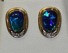 BA pair of opal and diamond stud earringsP Two slightly oval solid black opals measuring 10mm x 7mm, blue green in colour with s...