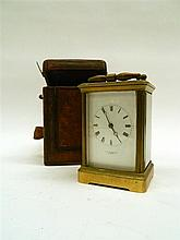 An Early 20thC Brass Mounted Carriage Clock with Moroccan Leather Case, retailed by E.W.Streeter London