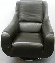 A Modern Brown Leather Armchair