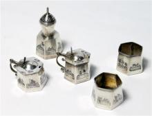 A five-piece Sterling Silver Egyptian Cruet Set in the Style of Niello