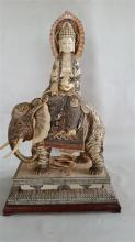 A Carved Figure of Guanyin Riding an Elephant
