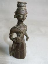 A Indian Bronze Figure of a Lady Holding a Bird