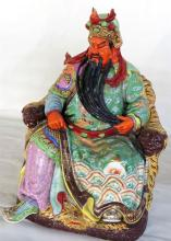 A Chinese Ceramic Figure of a Seated Emperor