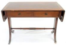 A two drawer desk with leather insert