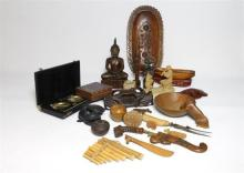 A collection of mostly wooden & clay objects, including a Chinese snuff bottle, a Thai Buddha, Indonesian Kris,