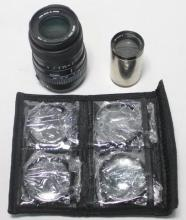 A 55-200mm Sigma zoom lense for Canon AF together with a Dallmeyer projection lense & a set of four macro lenses