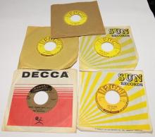 Four original Sun records (45 rpm), plus one Dodge label