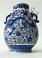 A Chinese porcelain Pear Shaped, double dragon handled vase in Qianlong Style.