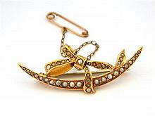 An Australian 15ct Yellow Gold Crescent and Bow Brooch