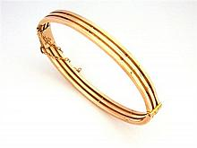 A Australian 9ct Rose Gold Three Bar Bangle