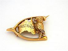 An Australian Wishbone Brooch with a Map of Australia and a Kookaburra