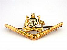 An Australian 9ct Yellow Gold Boomerang and Coat of Arms Brooch