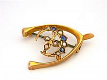 An Australian 9ct Yellow Gold Wishbone and Crescent Brooch