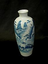 A Chinese blue and white vase depicting mountains