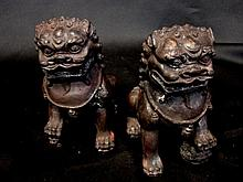 A pair of bronze lion dogs