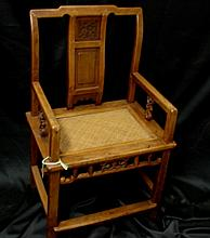 A Wooden Chinese Chair with Woven Cane Seat