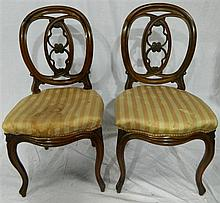 Two mahogany dining room chairs