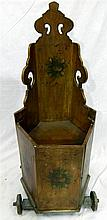 A Victorian continental child's chair on wheels with painted finish